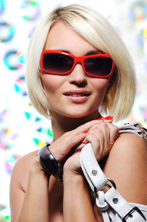 portrait of fashion beautiful young woman with sunglasses photo