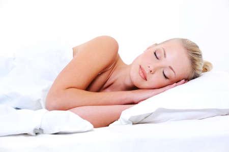 pillows: Beautiful young sleeping woman seeing sweet dreams