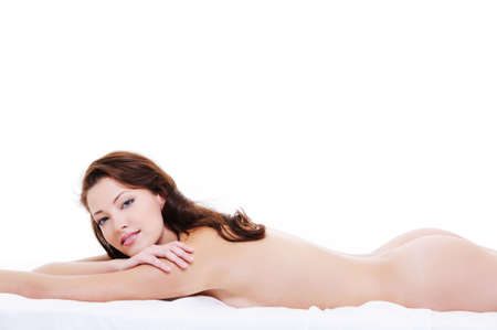 Beautiful bare body of a pretty young happy woman lying down on bed and looking at camera Stock Photo - 6477312