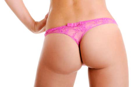Sexy et la forme parfaite d'un fessier nu féminin dans la petite culotte rose sexy Banque d'images - 6498669