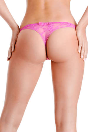 Slender and slim nude female body lower the waist. Rear view of girl buttocks photo
