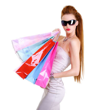 woman shopping bags: The cute glamour young caucasian woman with purchases in hands after shopping Stock Photo