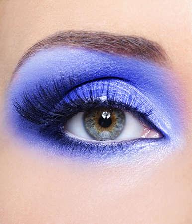 false eyelash: Bright blue fashion make-up of woman eye with a long false eyelashes Stock Photo