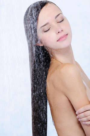 profile of beautiful girl taking shower - close-up portrait photo