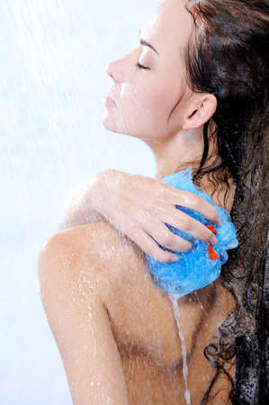 bodycare: bodycare by young beautiful woman taking shower - profile  Stock Photo