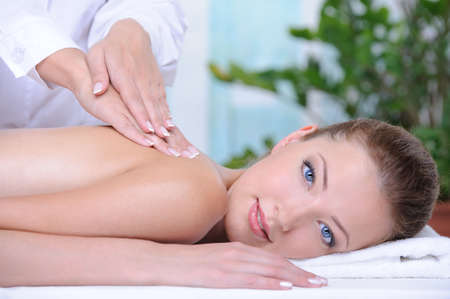 Relaxation and healthy massage for young woman in the spa salon  photo