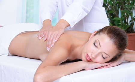 Relaxation and back massage for the beautiful pretty girl in beauty salon  photo