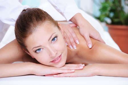 neck girl: Beauty serene woman getting relaxation in the spa salon