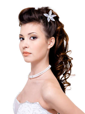 wedding hairstyle: Atractive young woman with beautiful wedding hairstyle - isolated on white