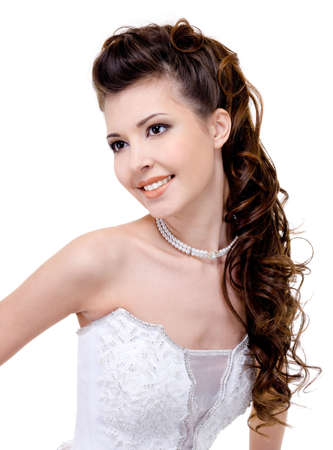wedding hairstyle: beautiful young smiling bride with modern wedding hairstyle - long curly hairs