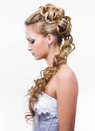 wedding hairstyle: Young brife with beauty wedding hairstyle, profile - isolated on white