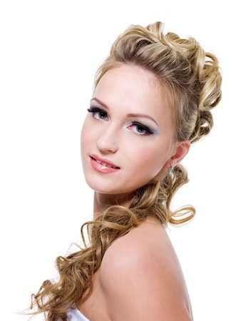 wedding hairstyle: Attractive young bride with beautiful wedding hairstyle - isolated on white