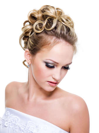 Beautiful bride with fashion wedding hairstyle -  on white background photo