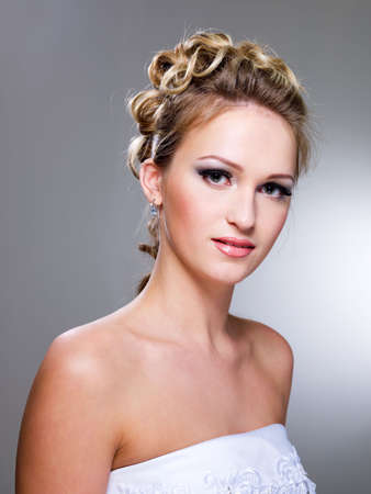 wedding hairstyle: Attractive young woman with beautiful wedding hairstyle - isolated on white   Stock Photo