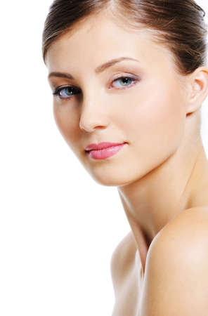 Serene woman face with a wellness complexion of her skin - isolated on white photo