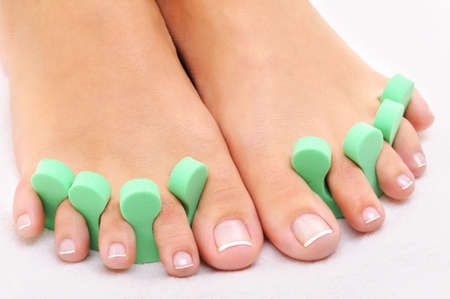 pedicure:  Beauty treatment photo of nice feet applying pedicure  Stock Photo