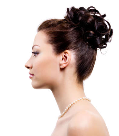 Profile portrait of an young bride with wedding hairstyle - on white background photo