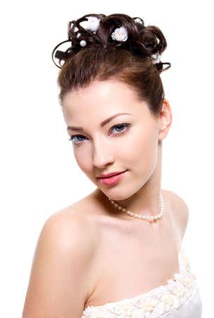 beautiful  bride with wedding hairstyle - on white background photo