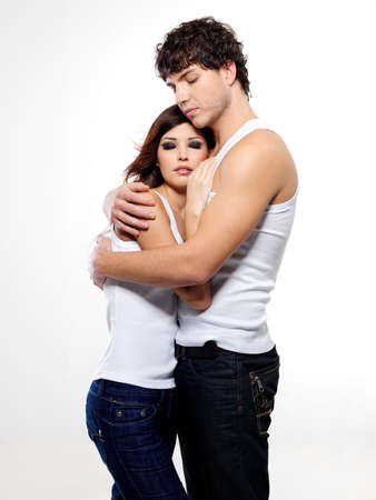 Two beautiful lovers embracing at studio Stock Photo - 6657116