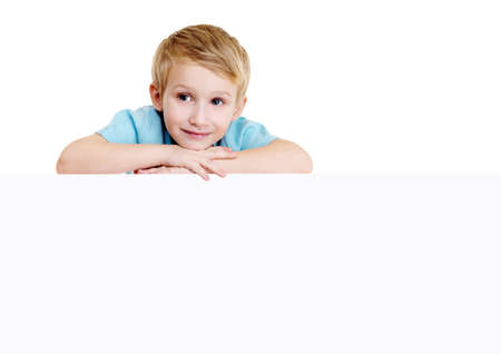 beautiful  little boy is above on the blank banner. isolated on white photo