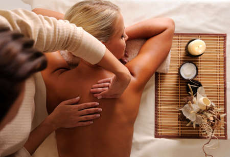 Female getting relaxation massage in beauty salon - high angle view Stock Photo - 6683067