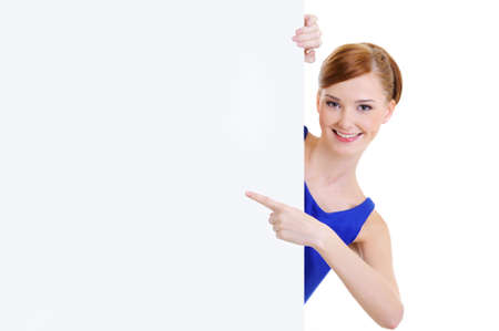 Beautiful happy woman points on message on the blank banner - isolated on white photo