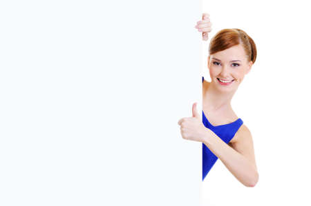 Happy casual girl  with a blank banner showing thumbs-up photo