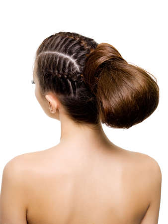Back view of a beauty  hairstyle from pigtails. On white background photo