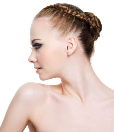 Beautiful woman with fashion coiffure. Profile portrait. On a white photo