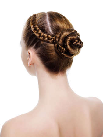 Rear view of a beautiful  coiffure from pigtails. On white background photo