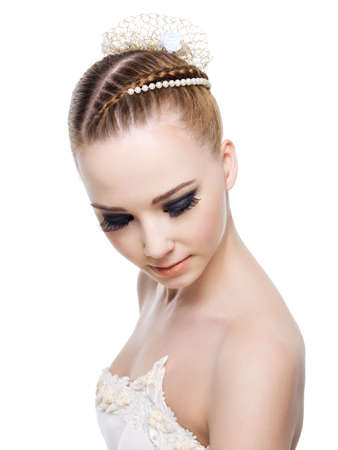 Beautiful woman with wedding hairstyle of pigtail. On white background photo