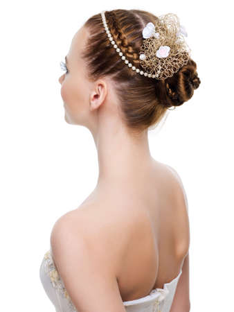 Beautiful wedding  hairstyle from pigtails. On white background photo