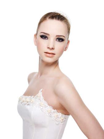 nude bride: Beautiful sensuality bride wearing wedding dress. Isolated on white. Stock Photo