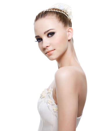 Beautiful elegance bride with beauty wedding coiffure . Isolated on white. Stock Photo - 6750462