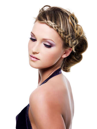 wedding hairstyle: Young beautiful woman with beauty hairstyle with pigtails - isolated on white Stock Photo