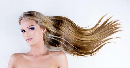 beautiful woman with long straight hair - lying down photo