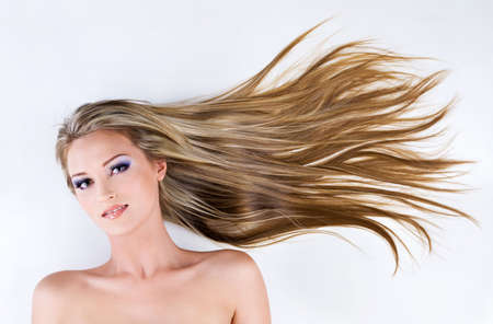 beautiful young female face with long blond straight hair as background Stock Photo - 6750484
