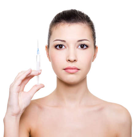 young beautiful woman holding medical syringe in hand - white background photo