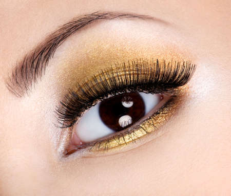 Eye make-up with bright fashion golden eyeshadow  photo