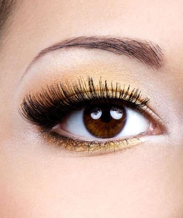 brow: Fashion eye make-up with golden eyeshadow - macro shoot Stock Photo