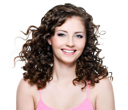 brown hair: Portrait of happy beautiful cheerful woman with long curly brown hair