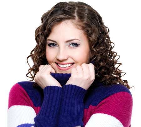 Beautiful cheerful smiling woman with colored warm sweater photo