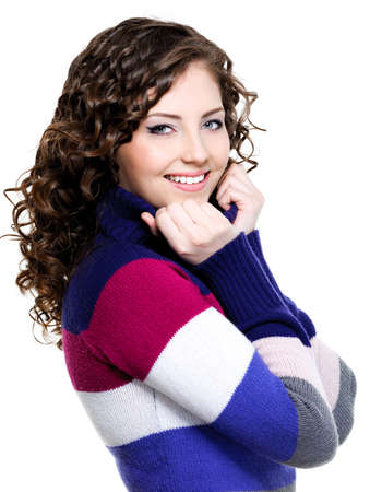 Beautiful portrait of nice pretty happy woman in multicolored winter sweater