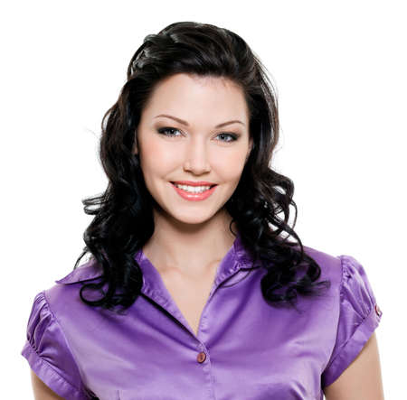 Beautiful young brunette woman with toothy smile photo