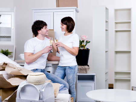 New home for young happy couple staying with stemwares - indoors Stock Photo - 6809026