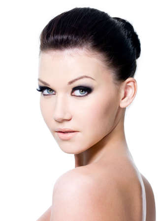 Beautiful portrait of pretty young woman with fashion eye make-up - isolated photo