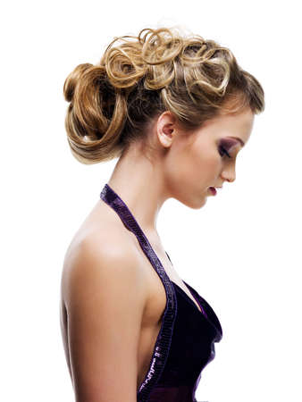 Profile portrait of a woman with beautiful curly coiffure - isolated on white Stock Photo - 6870023