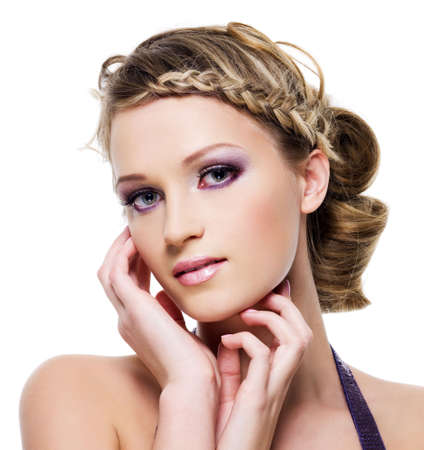 wedding hairstyle: Beautiful blond woman with fashion hairstyle with element of pigtail- on a white Stock Photo