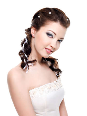 Beautiful young pretty bride with attractive easy smile photo