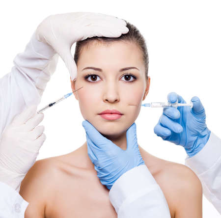 plastic glove: Plastic surgeons giving  botox injection in female skin of  eyes and lips - isolated white